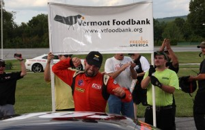 Travis Stearns of Auburn, ME celebrates his first career ACT win in the VT Foodbank Labor Day Classic 200 at Thunder Road. (Photo by Alan Ward).